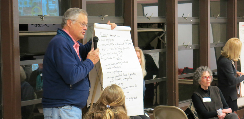 Fred Kent review flip charts from the Mar 1 breakout groups at a meeting about the Los Altos Community Center
