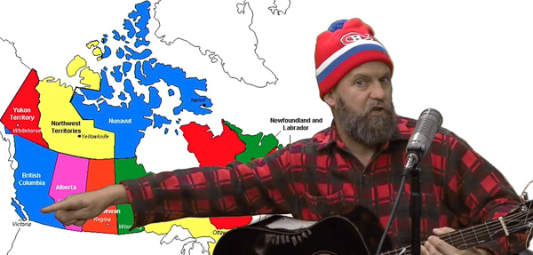 Man in front of map of Canada