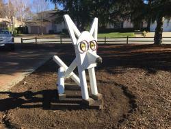 Sit a modern dog sculpture