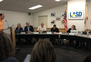 LASD trustees seated at the regular meeting table listening to a public commenter